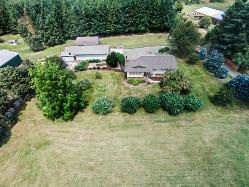BEAUTIFUL SETTING!  ~ 9.91 acres!  7 BR Home, Shop + RV Garage!  See Virtual Tour