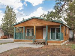 THIS BEAUTIFUL, BRIGHT & SPACIOUS LOG-STYLE MANUFACTURED HOME - RIVERSIDE